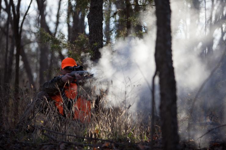 hunter shooting a muzzleloader